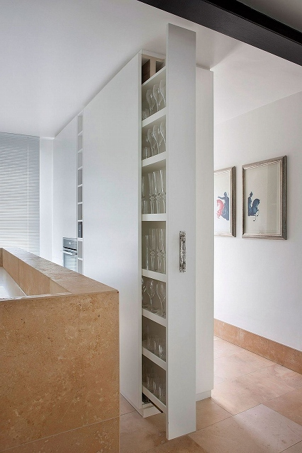 Cleverly-concealed-cabinets-and-shelves-give-the-kitchen-a-clean-modern-look.jpg