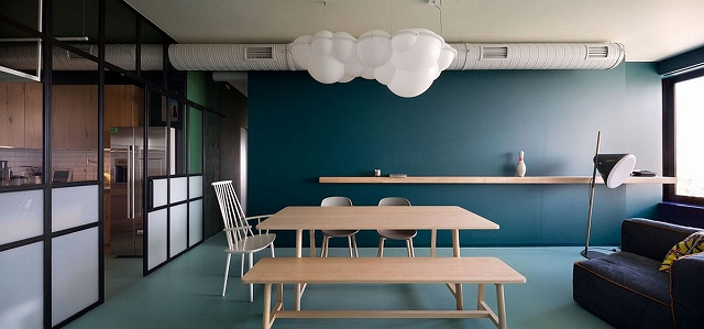 Dining-room-with-exposed-duct-pipes-and-minimal-decor.jpg