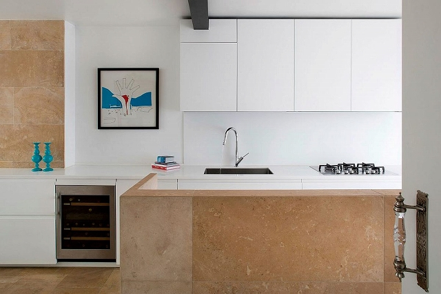 French-honey-color-limestone-brings-warmth-to-the-neutral-interior.jpg