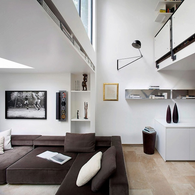 Glass-windows-and-improvised-ceiling-design-give-the-interior-an-airy-appeal.jpg