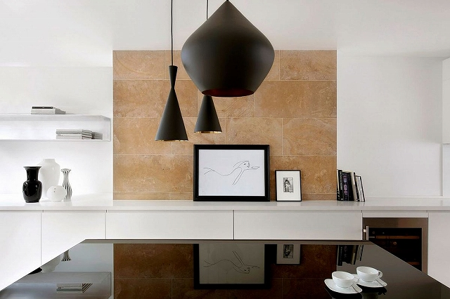 Limestone-backdrop-for-the-dining-room-in-white-with-dark-pendants.jpg