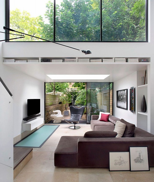 Sliding-glass-doors-connect-the-living-room-with-the-rear-yard.jpg