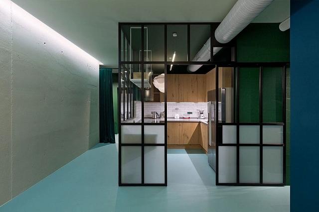 Tiled-backsplash-and-wooden-cabinets-for-the-kitchen.jpg