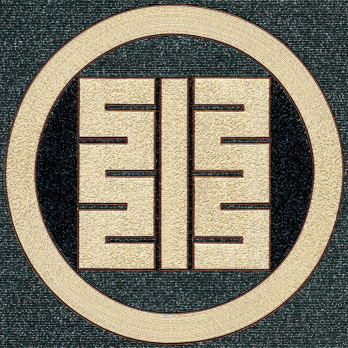 丸に小の角字紋