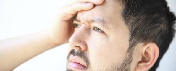 young-man-headache.jpg